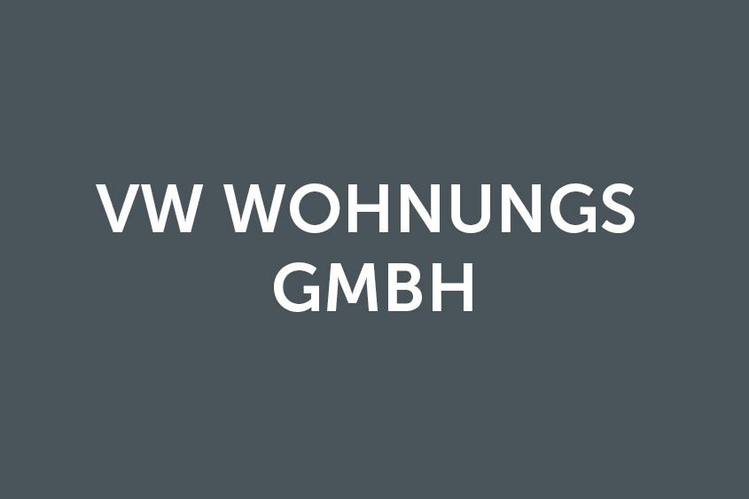 Weißes VW Wohnungs GmbH Logo auf grauem Hintergrund